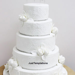 white wedding cake with few flowers