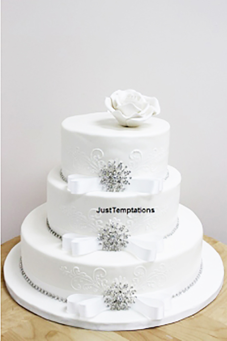 3 tiered white wedding cake