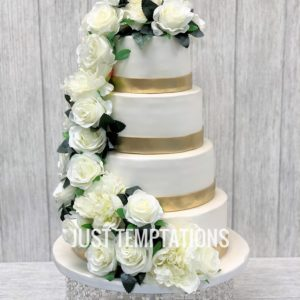 white flowers and gold wedding cake
