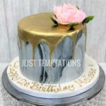 gold dripping marble birthday cake