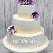 cream and purple 3 tiered wedding cake