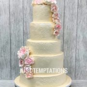 cream pearls wedding cake with flowers