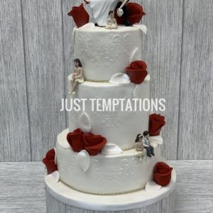 white and red flowers wedding cake