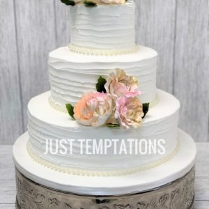 floral white butter cream wedding cake