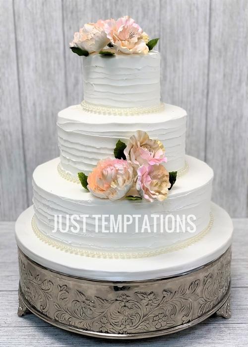 floral white butter cream wedding cake
