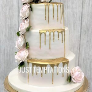 gold and pastel pink wedding cake