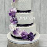 white and purple cascading floral wedding cake