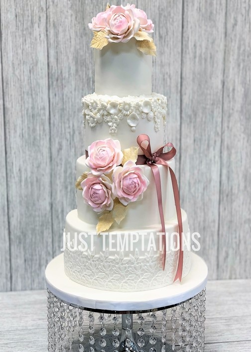 cute engraved floral white and pink wedding cake