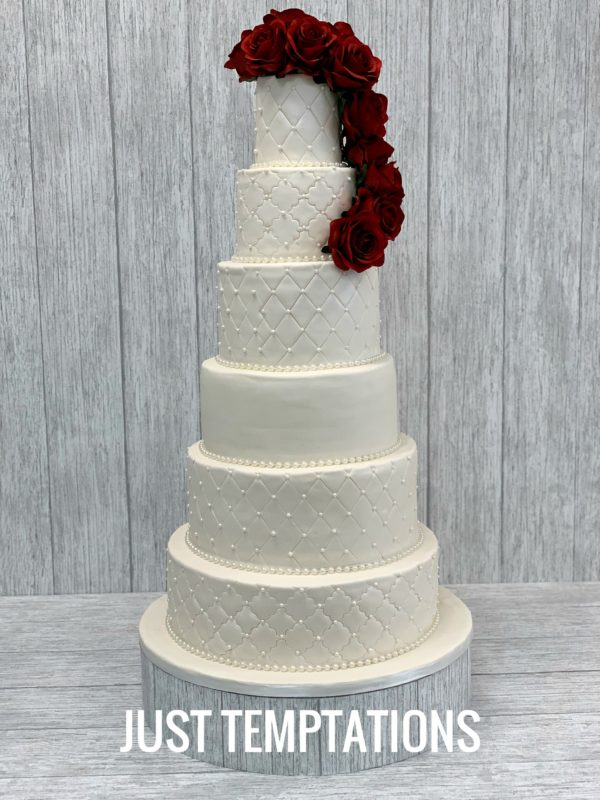 big wedding cake with red flowers